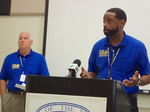 Bob Moquin and Kelvin Nelson of the SBA speak at UVI Tuesday.