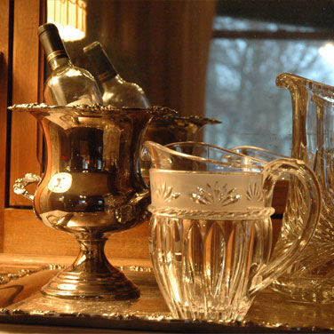 Silver urn with two bottles chilling, and two crustal pitchers.