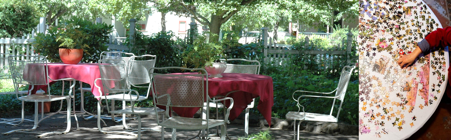 Split screen: stone patio with tables covered in red cloth, with white chairs in lush garden; puzzle pieces spread out and a hand placing them together