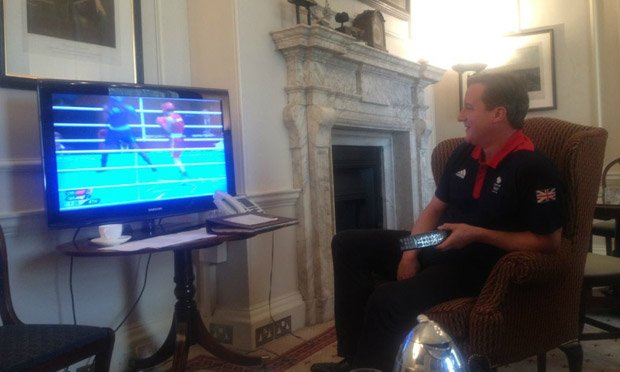 David Cameron watching the boxing during the London Olympics photo
