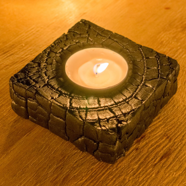 Burnt candle holder