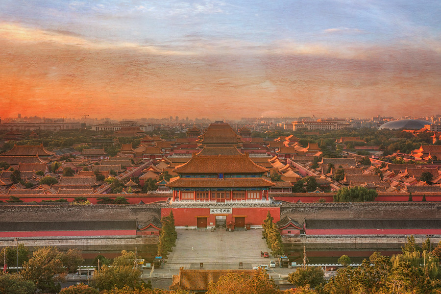 The Forbidden City Early one morning I decided to hike up the biggest hill in the middle of Central Axis to get a shot of the Forbidden City.Once up there, it was an amazing view of the old city.  There's not many cities in the world that have kept such a huge area so well preserved.  It's about as close as you can get to time travel in the real world (so far).  And then, when the light is right in these strange hours, it is a completely transportive experience.- Trey RatcliffClick here to read the rest of this post at the Stuck in Customs blog.