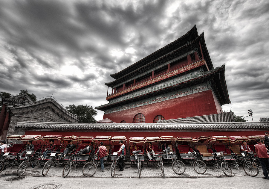 Rickshaws at the Drum Tower I've visited Gǔlóumany times and never taken a photo. I just couldn't figure one out.And then, this most recent trip, I walked around the tower several times until I finally got an idea.This is the giant drum tower built about a thousand years ago by Kublai Khan. An enormous drum rests in front, and it was beat rhythmically to announce meetings. The temple sits in the Inner City to the north of Di'anmen Street.- Trey RatcliffRead more, including a preview of an exciting announcement, here at the Stuck in Customs blog.
