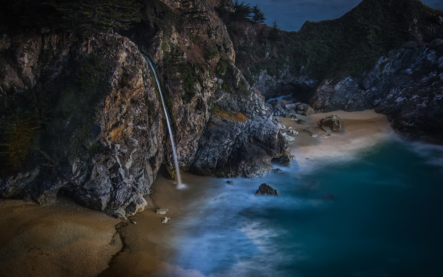 "Moonrise Kingdom This is one of my favorite new pieces from this year! I just shot it a few days ago.It was shot waaaay after the sun went down in Big Sur, California. This is a crazy waterfall that pours off onto the beach. You can't see it from the road, and it requires a short walk. I found it thanks to Stuck On Earth, although I am sure other locals have known about this semi-secret place forever! You can go here too… it's not terribly difficult. It's called ""McWay Falls"" and it's beautiful any time of the day.Also, btw, I'd like to thank those of you that have been ordering more prints recently — I am honored! :) You can always click just below the photo to check sizes and prices to find something to fit your budget. Thanks again!- Trey RatcliffClick here to read the rest of this post at the Stuck in Customs blog."