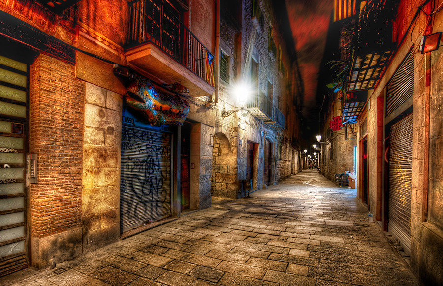 The Endless AlleyThe dirt and grit and color that comes with European alleys make for great subjects for dynamic night photography.  Usually I only stay out for about an hour after it gets dark, but it's hard to stop with this kind of scenery...  I mean, you can make a legitimate excuse to stay out all night!But a lot of people warned me about how dangerous Barcelona can be...  I did already meet many people that were robbed blind...  I was extra-extra careful... and, in this case, decided to head back to the hotel early.  Also, I was feeling pretty under the weather...so yet another excuse.- Trey RatcliffRead more, including my top-five Instagram list,  here at the Stuck in Customs blog.