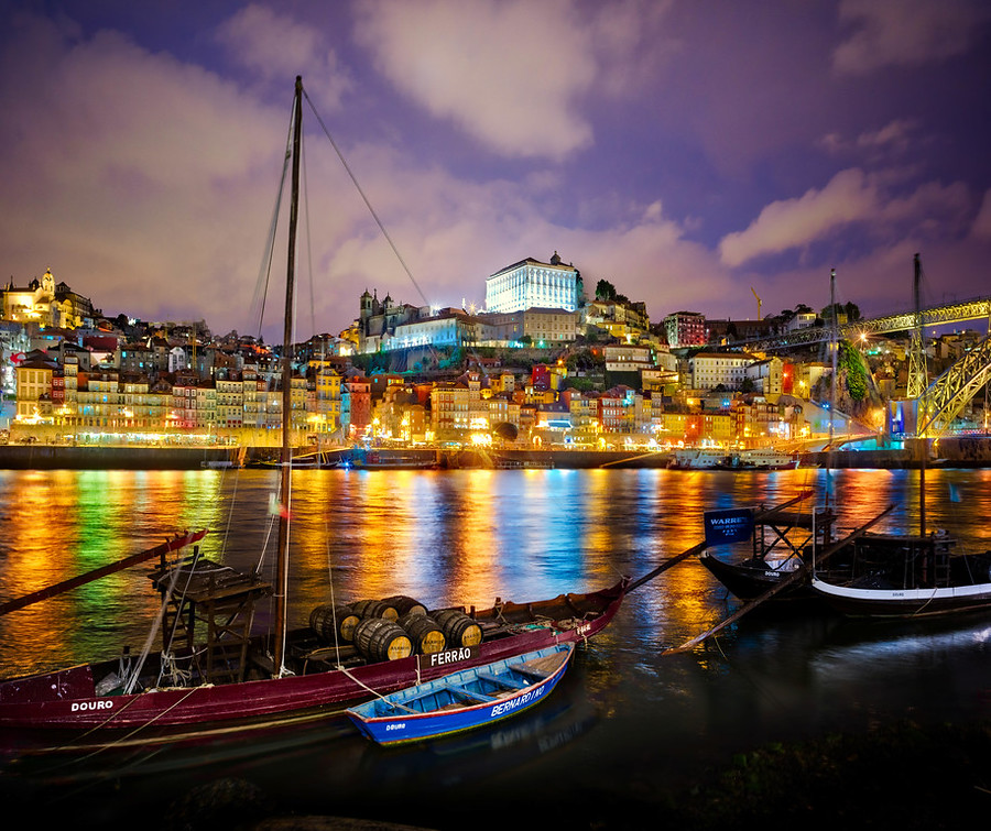 Porto,  Portugal. What a great place for photography. This photo has a bit of artifice involved, I'm afraid. I took two photos... a longer exposure and then a faster one so that the boat was not moving. I combined them in Photoshop.