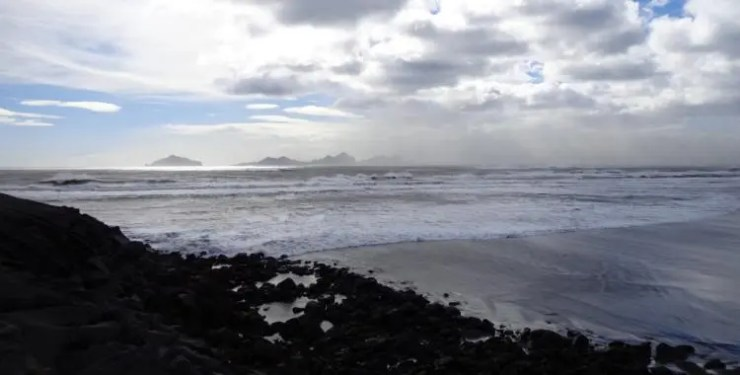 The Westman islands loom in the background as storm pounds the coast.