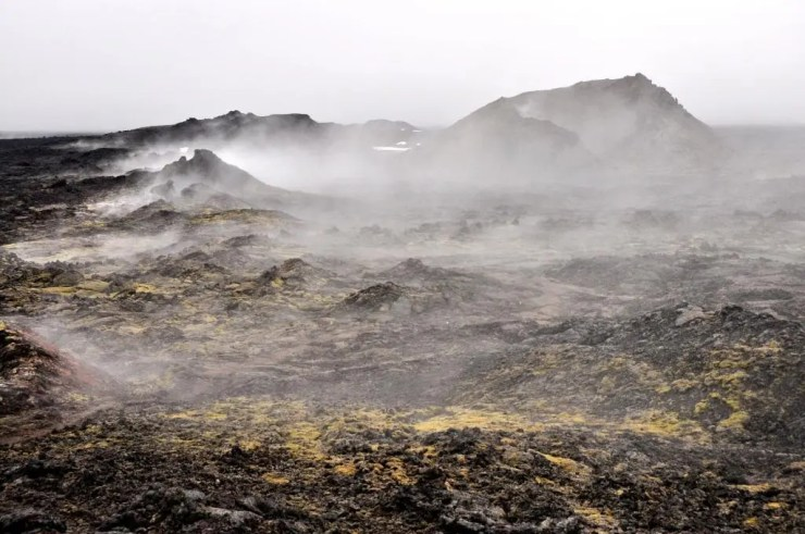The Krafla is a central volcano in the north of Iceland with a caldera of about 10 km   in diameter and a 90 km long fissure zone, which are caused by the continental   drifts. There have been 9 eruptions here between 1975 en 1984 and we still see the   fresh black lava and smoking fissures and fumaroles.