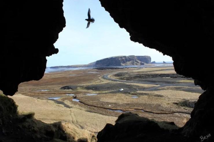 Dyrholaey seen from Loftsalahellir cave.