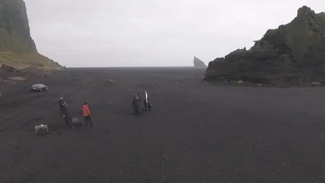 Filming on the black beach.
