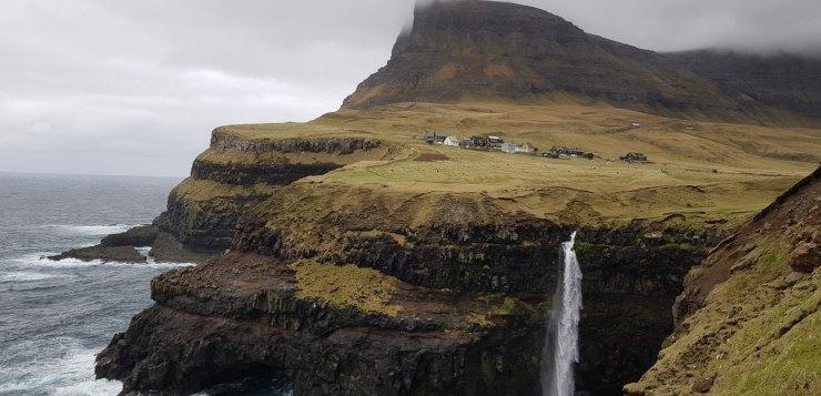 Travel to the Faroe Islands and see the beatiful Múlafossur waterfall.