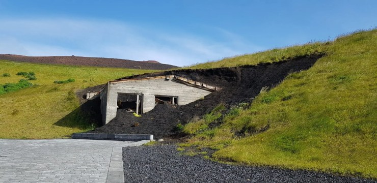 A house buried in volcanic material from the 1973 Westman Island eruption partially excavated.