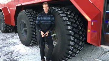 Michael Mann EU Ambassador to Iceland standing next to a truck that takes travelers to the Langjökull ice tunnel.