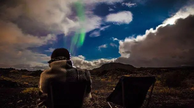 The Northern lights being photographed in Iceland.