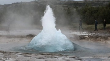 Strokkur geyser on the Golden Circle route in Iceland is just about to erupt. Still image from video by Tom A. Warner.