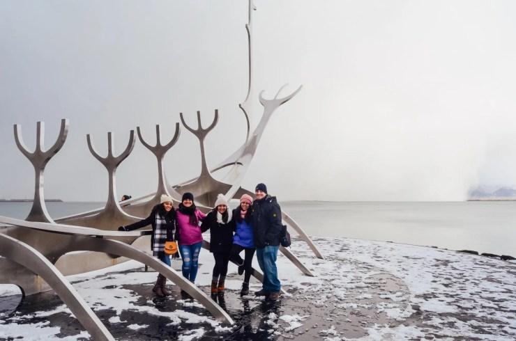 Four travelers by the Sólfar in Reykjavik.