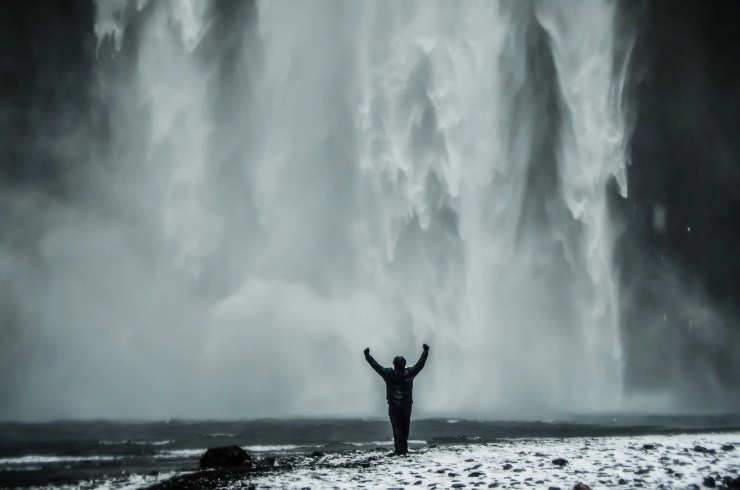 Man by the Skógafoss Waterfall.