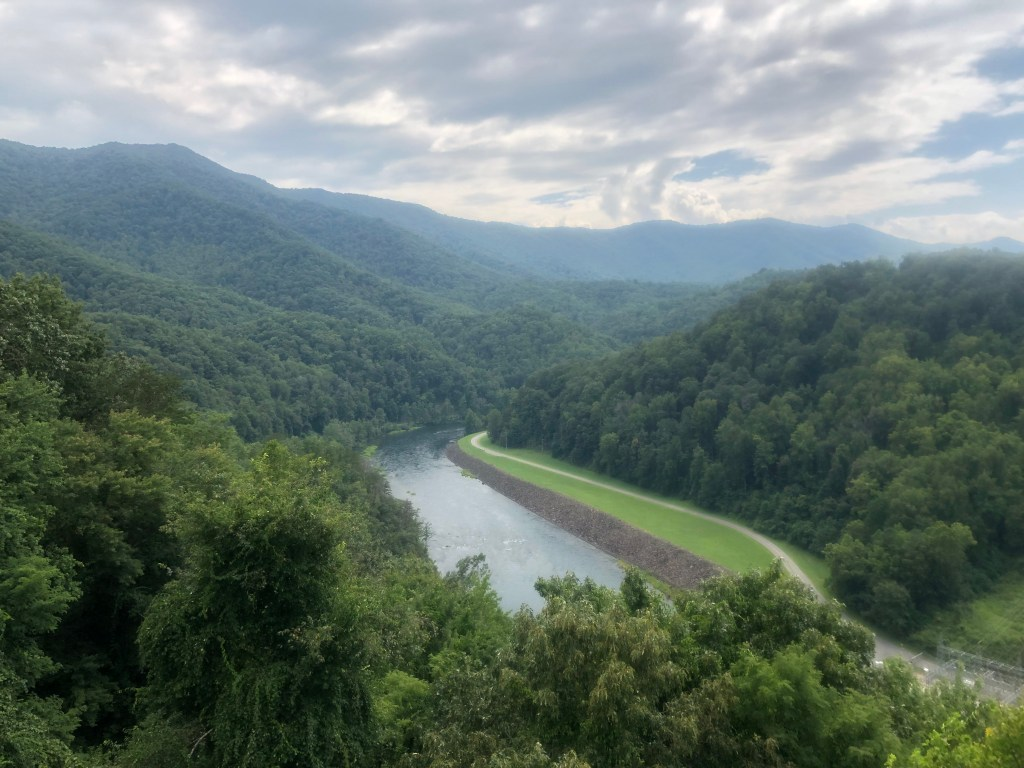 On top of the observation deack at Fontana Dam you can see the surrounding mountains and river flowing from the dam. You can also backpack in this area during NC weekend trips.