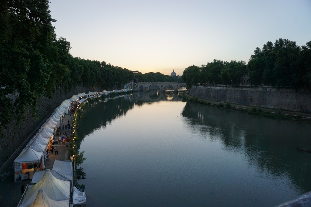 If you are looking for what to do in Rome, then venturing over into the Trastevre neighborhood is a must. You get this view as you cross over the Tiber River from downtown.