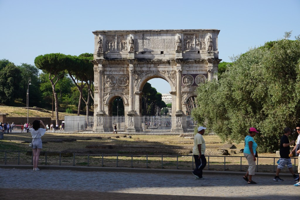 The Arch of Constantine is located right outside of the Colosseum.