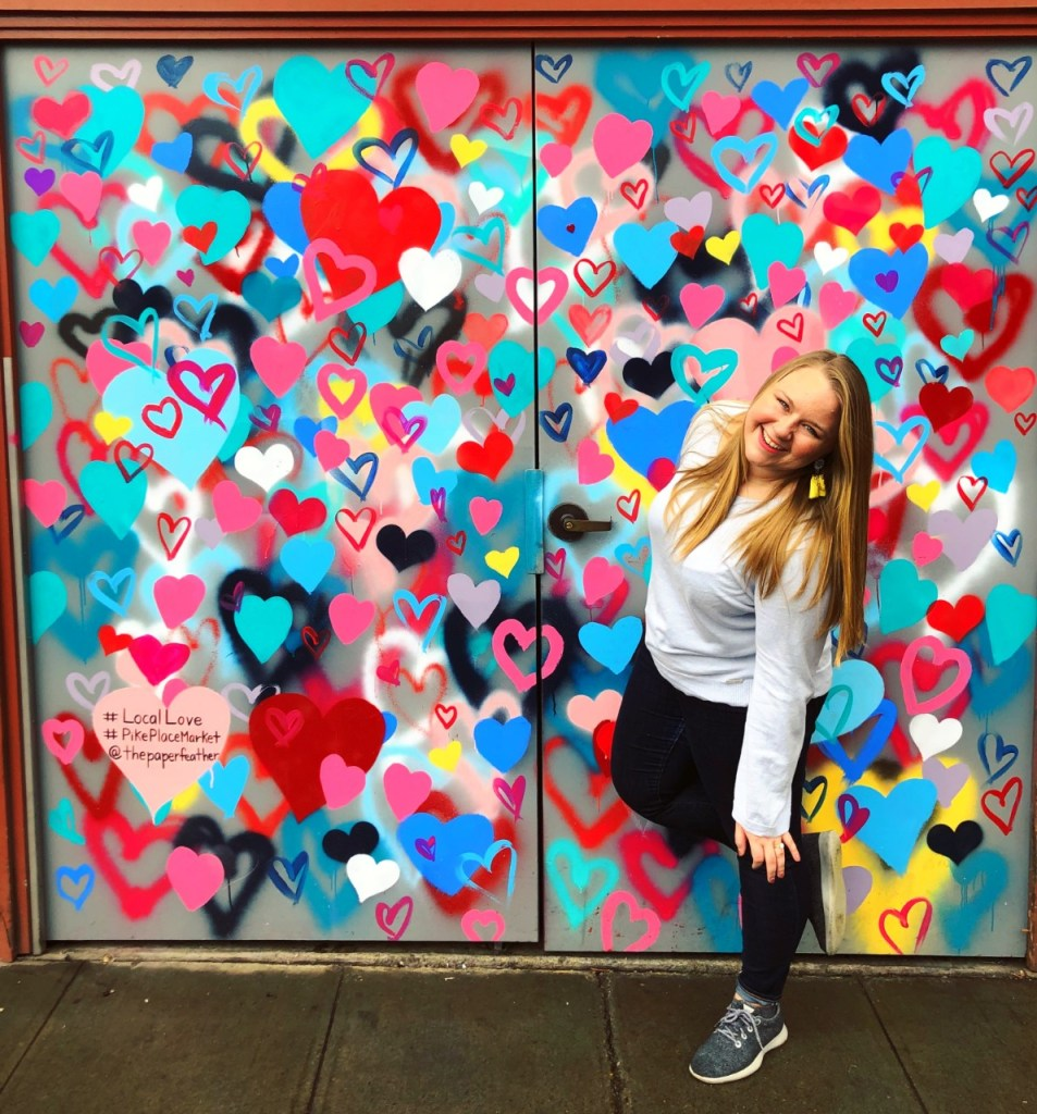 A wall full of multi-colored hearts. Part of the Pike Place Market Mural Seattle Art tour.