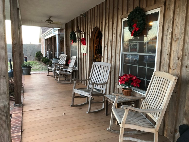 The front porch of a winery with rocking chairs. The cabin at Carolina Heritage is one of the best places to stay in North Carolina.