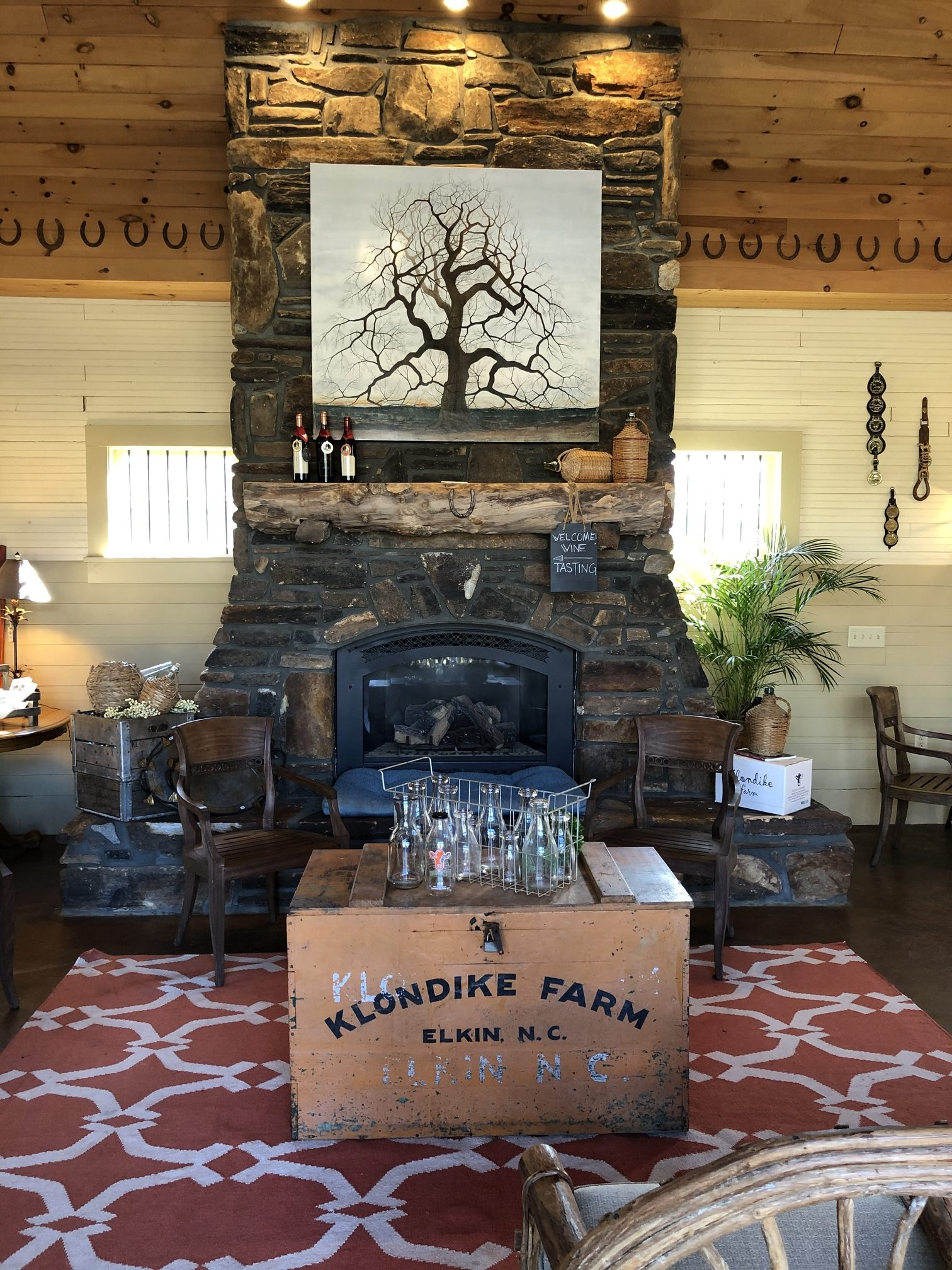rock fireplace with rustic decor surrounding it at Grassy Creek Vineyard - yadkin valley wineries