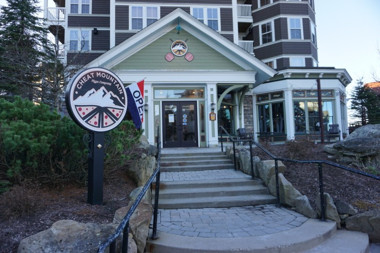 Front entrance to a restaurant with pylon sign outside. Best Snowshoe, WV restaurants.