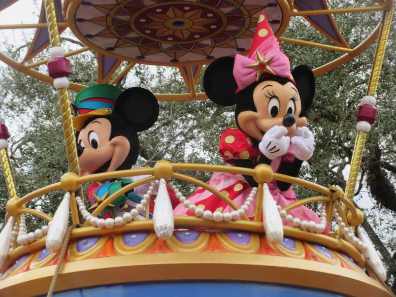 Minnie and Mickey Mouse on top of a float at one of the best theme parks in the US