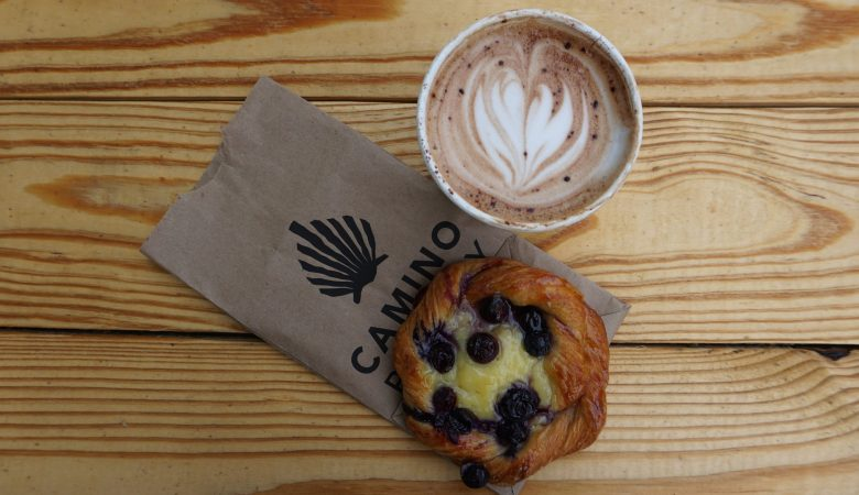 Blueberry danish with hot mocha on a wooden table