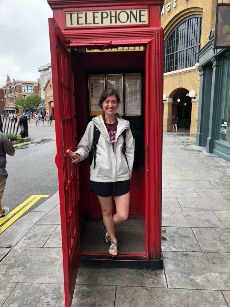 woman in telephone booth with best shoes for theme parks