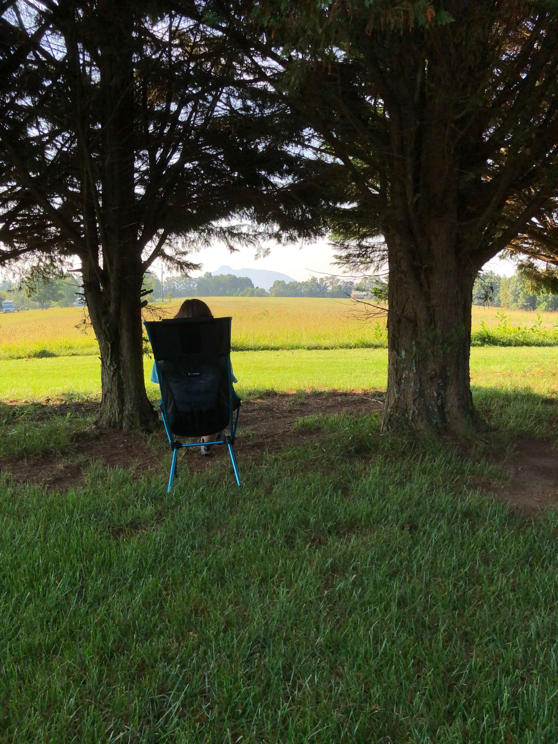 girl sitting in camp chair