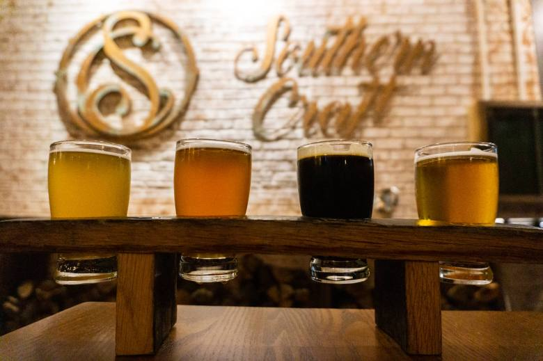 beer flight with Southern Craft BBQ sign in background