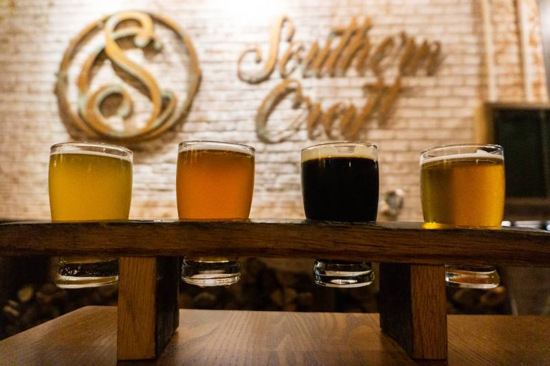 beer flight in front of Southern Craft sign