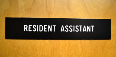 a door with the sign resident assistant on it