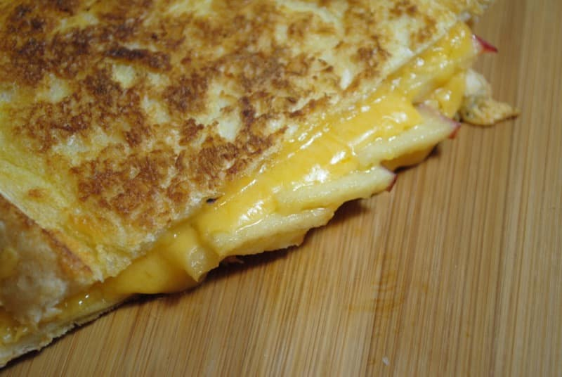 Melting cheddar cheese and apple toastie