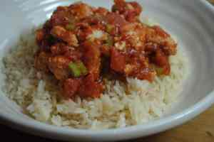 Fish in tomato and spring onion sauce
