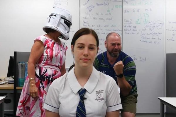 Teachers Photobomb Graduating Students