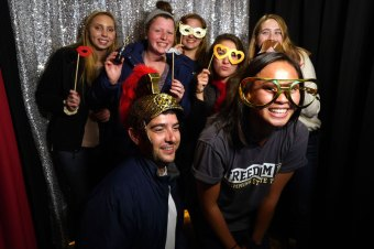 students posing in photobooth
