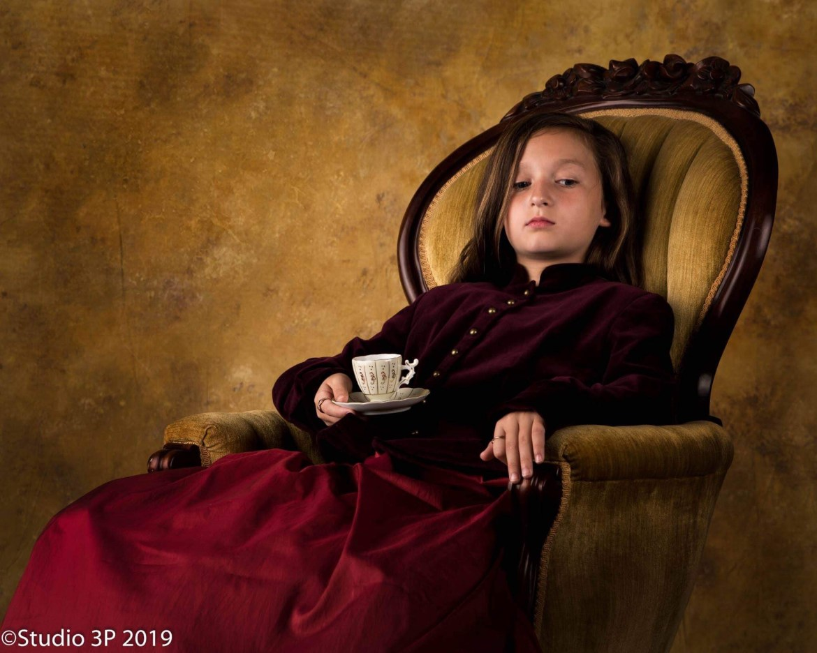 young girl sitting in a chair