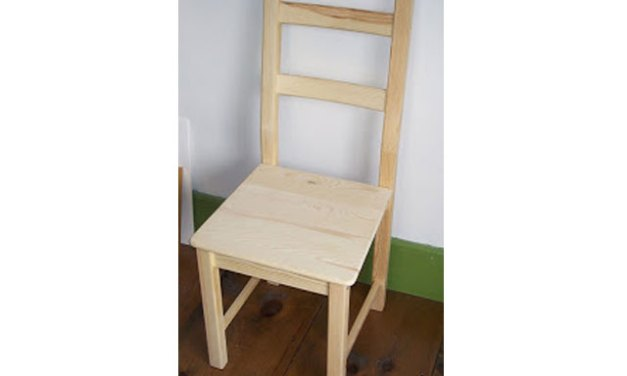Painting a scene on a wood chair for charity