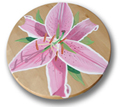 pink lily hand painted on a wood lazy susan