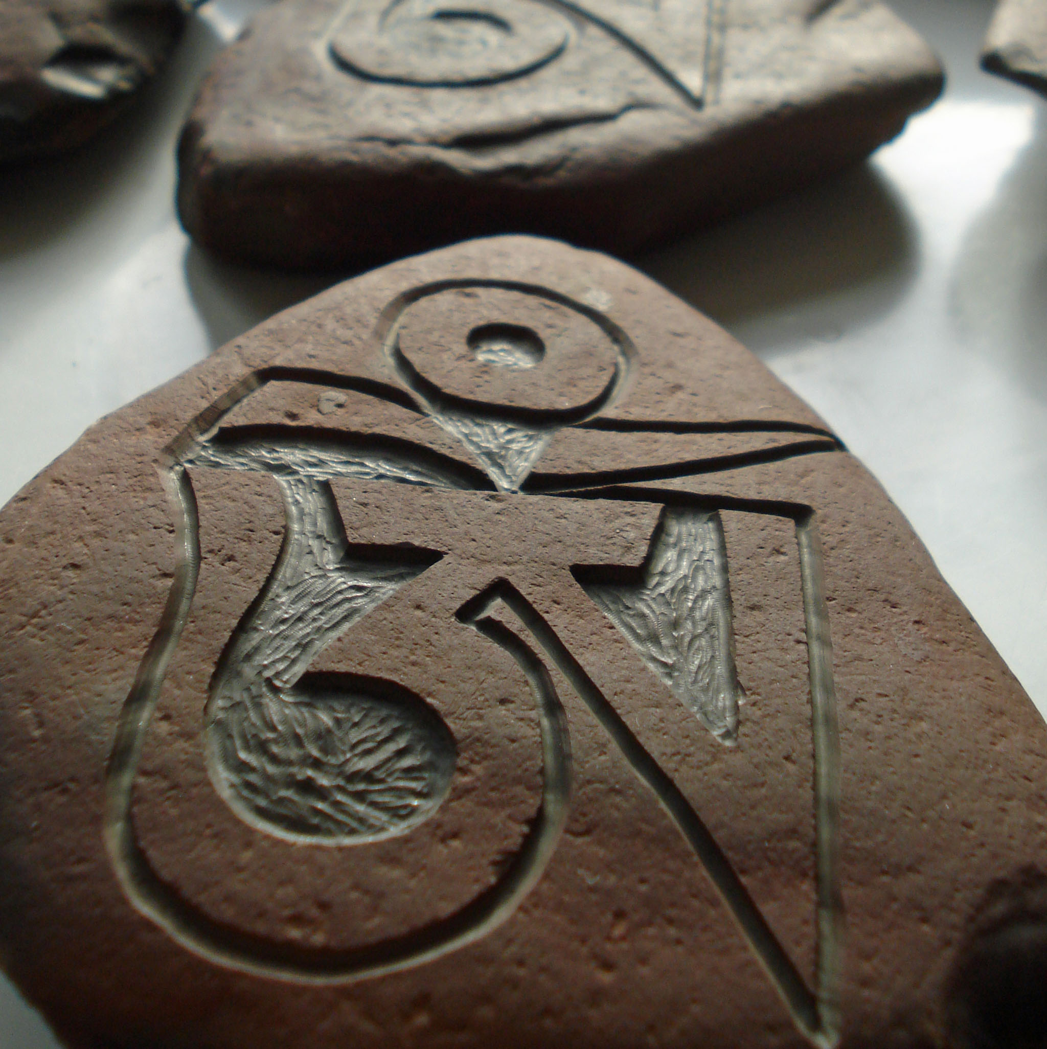 Hand Carved OM Stone Santosa