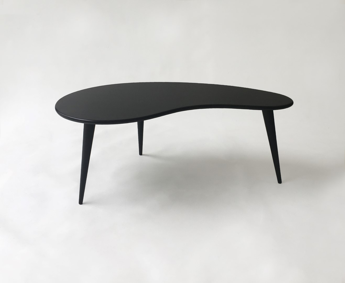 - Black Mid Century Modern Coffee Table With Tapered Legs