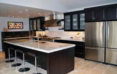 Dark stained cabinets and frosted glass in modern kitchen remodel