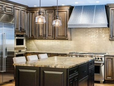 Traditional kitchen design cabinets, industrial hood, professional range, island with seating