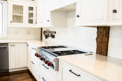 Wolf cooktop, white cabinets, glass cabinet doors