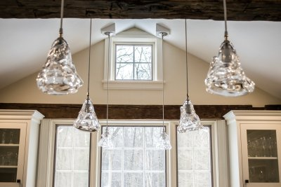 Wood beams, vaulted ceiling, glass pendant lights