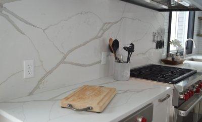 Features a white quartz slab backsplash