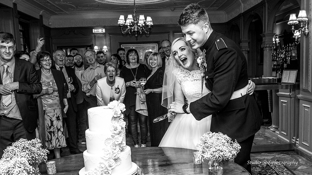 Cake cutting and laughing